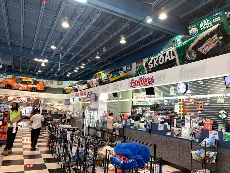 Race cars over head inside the Summit Racing showroom